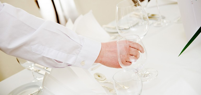 Service is setting the table for your party