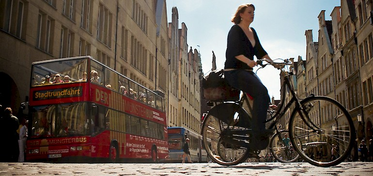 Discover Muenster with the popular red bus or by bike