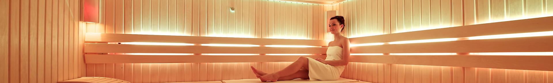 A woman sitting in the sauna
