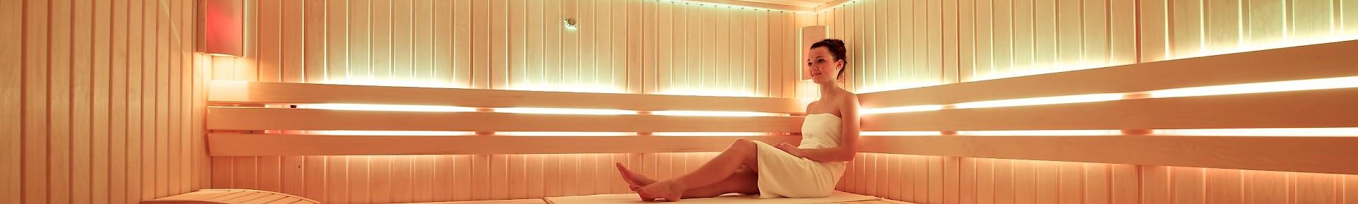 A woman sitting in the sauna