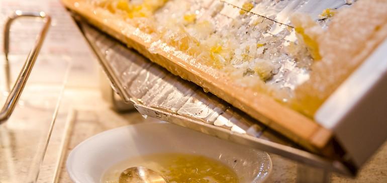 Enjoy honey from a honeycomb